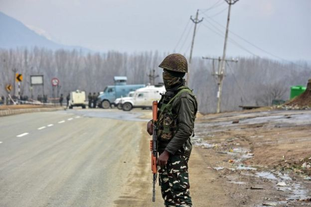 A paramilitary trooper seen standing guard close to the site of the blast, about 28kms from Srinagar.