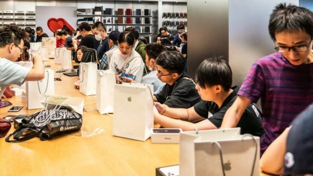 Customers activate new iPhone 11 series smartphones after purchase at an Apple retail store on East Nanjing Road in Shanghai. Apple launched sales of its latest iPhone 11 series in China.