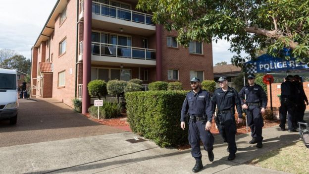 Police outside flats in the Sydney suburb of Lakemba