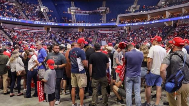 Supporters of U.S. President Donald Trump wait for him to appear onstage 27 minutes before the scheduled start of his speech, at his first re-election campaign rally in several months in the midst of the coronavirus disease (COVID-19) outbreak,