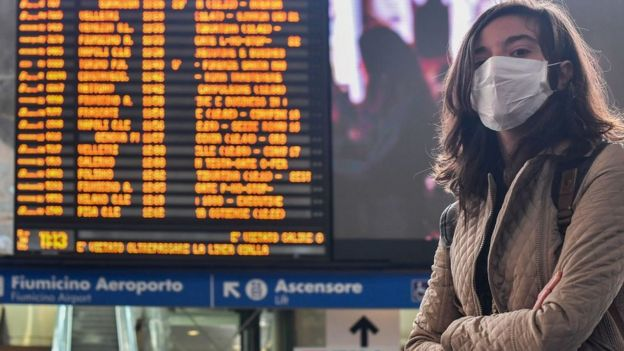 Woman with mask at Rome's Termini train station