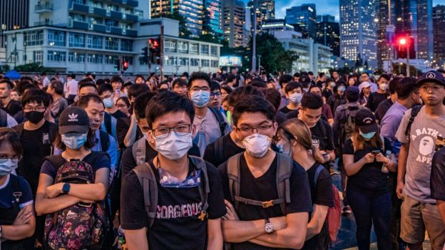 Protesters (protestors, demonstrators) occupy a street demanding Hong Kong leader to step down after a rally against the now-suspended extradition bill outside of the Chief Executive Office on June 17, 2019 in Hong Kong China