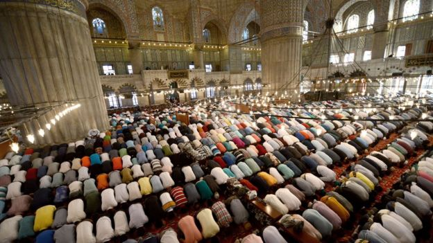 Turkey country profile bbc news worshippers pray inside the blue mosque in istanbul publicscrutiny Image collections