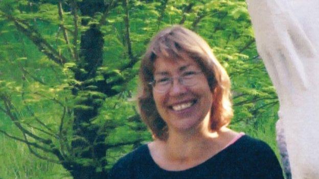 Jane Rickards smiles in a garden