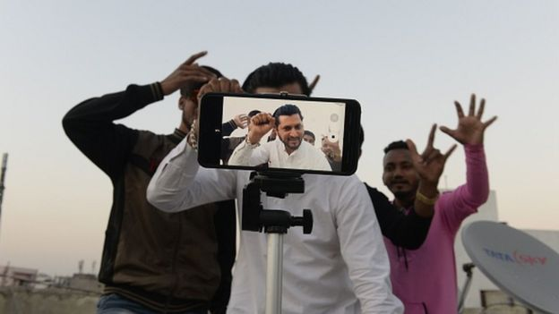 Young Indian men making a TikTok video in Hyderabad.