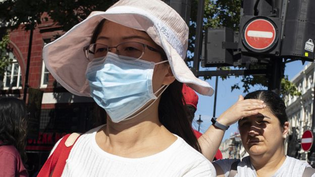 File image of a woman wearing an anti-pollution mask in London