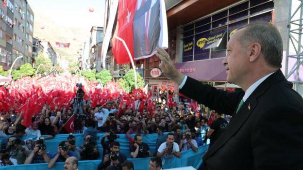 Mr Erdogan speaks to a crowd