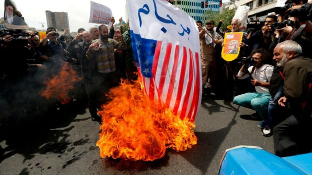 Protesters burn an American flag in Tehran