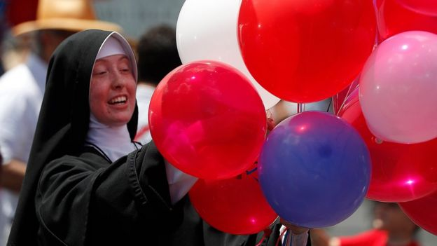 Traditional Catholic nun Sister Mary Augustin hands out red, white and blue balloons during a Fourth of July parade and celebration at the Motherhouse of the Daughters of Mary Convent in Round Top, New York, USA, 04 July 2017