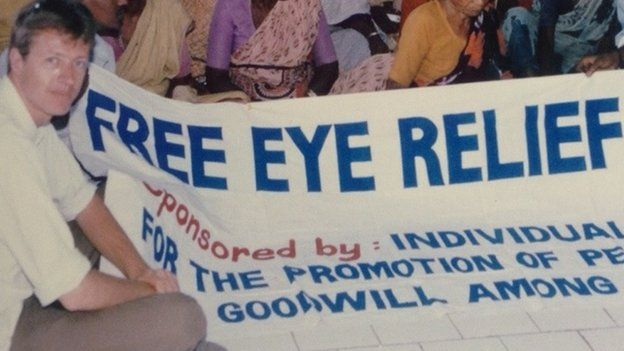 Mark Bloomfield with a giant sign saying 'free eye relief'