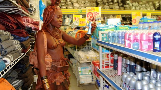 A Himba woman goes grocery shopping in Opuwo. Exposure to this busy visual environment may permanently change her perception