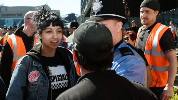 Saffiyah Khan in a stand-off in her Specials T-shirt with the EDL's Ian Crossland, during the protest in 2017 in Birmingham