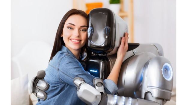 Woman and robot hugging