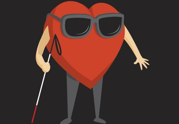 Corazón con un bastón de ciego.