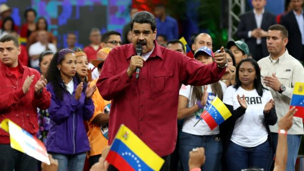 Handout photo shows Venezuelan President, Nicolas Maduro (C), during a rally of supporters in Caracas, Venezuela, 27 June 2017