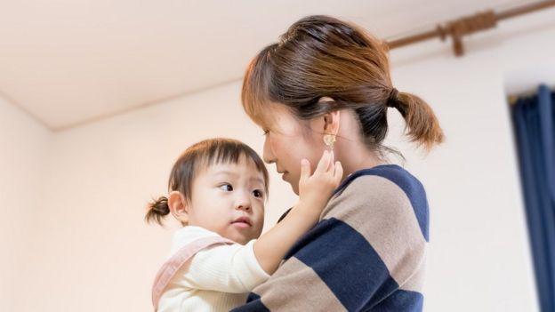 Mujer con hija