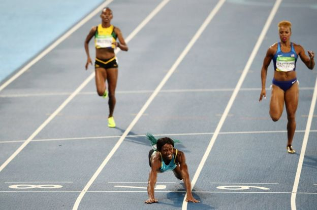Shaunae Miller of the Bahamas dives over the finish line