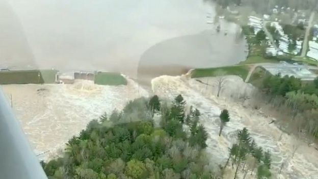 Aerial view of water from a broken Edenville Dam seen flooding the area as it flows towards Wixom Lake in Michigan