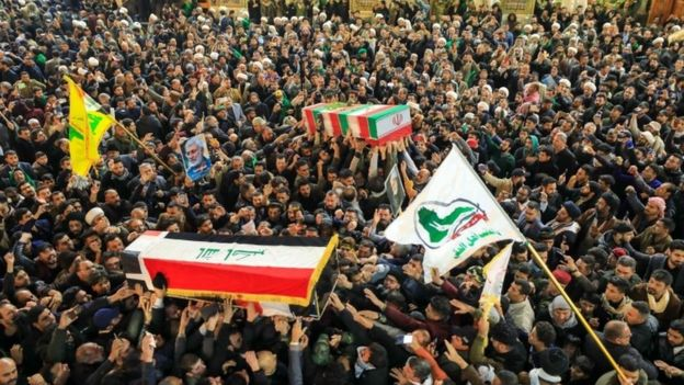 People mourn next to the coffins of slain Abu Mahdi al-Muhandis and Qasem Soleimani during a funeral procession in Najaf, Iraq, 04 January 2020  Trump: Iran 'standing down' after missile strikes  110428383 mediaitem110428382