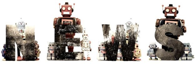 Toy robots next to letters spelling NEWS