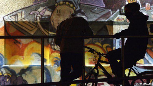 Teenagers on bikes in silhouette