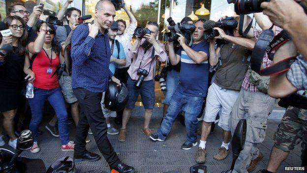 Yanis Varoufakis surrounded by media