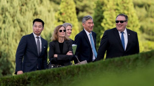 Deputy Assistant Secretary for the Bureau of East Asian and Pacific Affairs Alex Wong, aide Lisa Kenna, NSC Korea Director Allison Hooker, US Ambassador to the Philippines Sung Kim, and Secretary of State Mike Pompeo walk back into the Park Hwa Guest House
