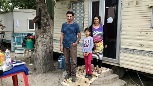 Roma families live in trailers in River camp