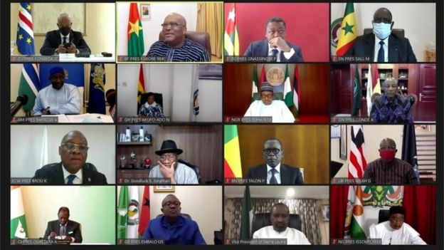 A screenshot shows a teleconference during the extraordinary Summit of the Economic Community of West African States (ECOWAS) Authority of Heads of State and Government on the Socio-Political Situation in Mali August 20, 2020.