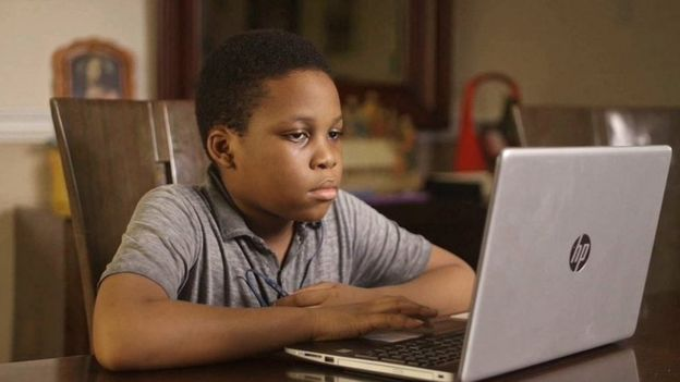 A child studying using the Gradely e-learning platform
