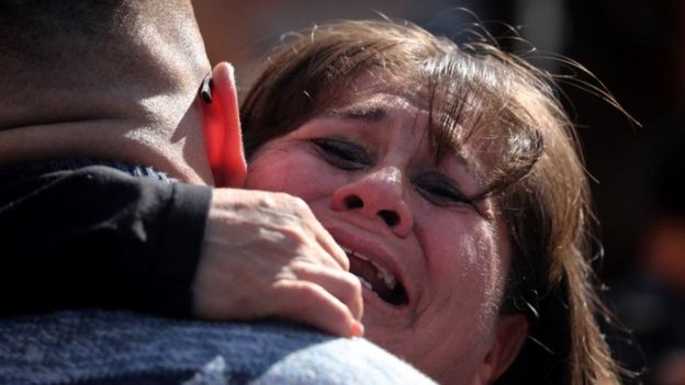 A woman hugs a man at the opening of the border