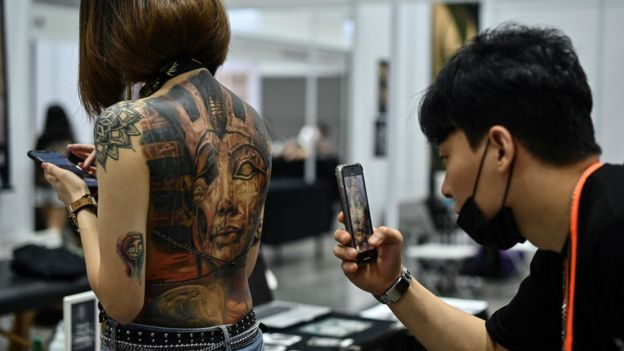 Woman with a tattoo on her exposed back