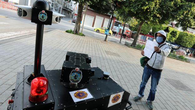 A police robot questions someone in Tunis, Tunisia - 1 April 2020