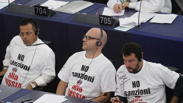 Member of the european parliament and the Italian far right Party Lega Nord, North league, Gianluca Buonanno, L, Lorenzo Fontana , Matteo Salvini wear t-shirts with a slogan reading, no sanzioni alla russia, ( no to Sanctions to Russia) in the plenary room ahead of the vote to the EU-Ukraine association agreement on September 16, 2014 in Strasbourg, France
