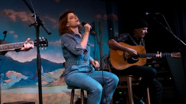 Jessie Buckley performing