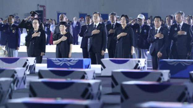 South Korean President Moon Jae-in salutes to caskets containing remains of South Korean soldiers killed during the Korean War during a ceremony commemorating the 70th anniversary of the Korean War at Seoul Air Base in Seongnam, South Korea, June 25, 2020