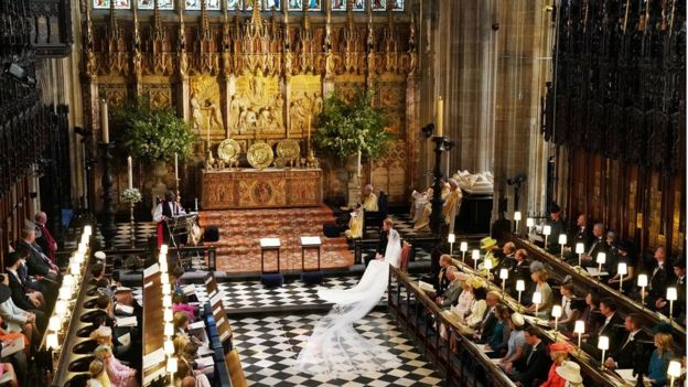 Prince Harry and Meghan Markle listen to an address by the Most Rev Bishop Michael Curry, primate of the Episcopal Church, in St George's Chapel at Windsor Castle during their wedding service in Windsor, Britain, May 19, 2018