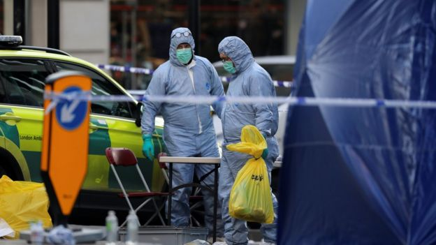 Forensic officers work at the scene of a stabbing on London Bridge