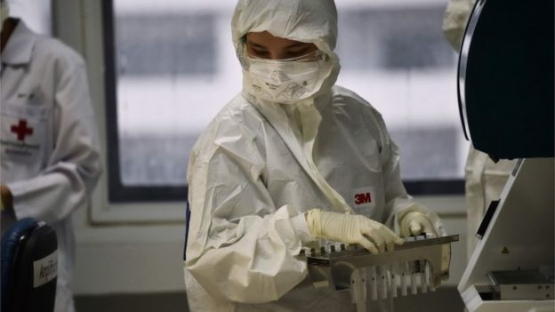 Lab technicians test patient samples for the novel coronavirus at the Centre for Emerging Infectious Diseases of Thailand at Chulalongkorn University in Bangkok on February 5, 2020.