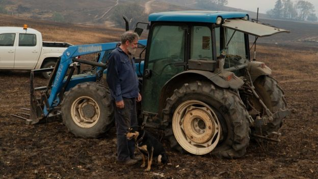 Neil in front of the broken tractor
