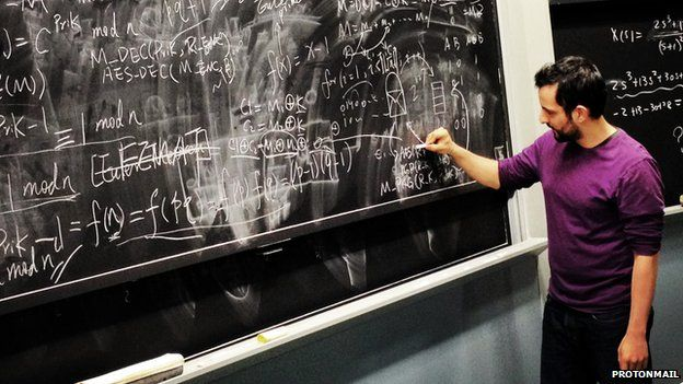 ProtonMail's Jason Stockman writing on a blackboard