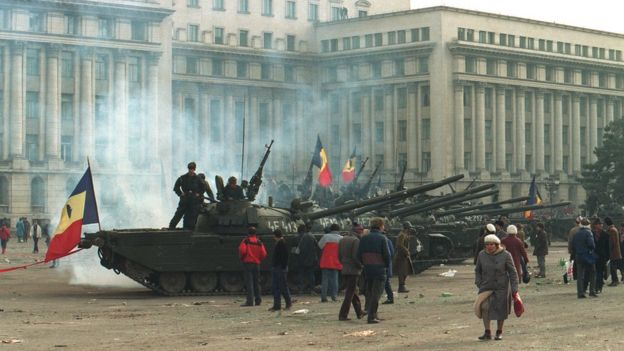 Tanks outside a government building in Bucharest during the Romanian revolution