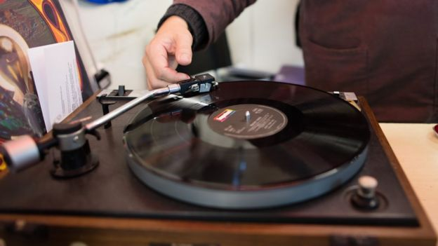 A vinyl record on a turntable