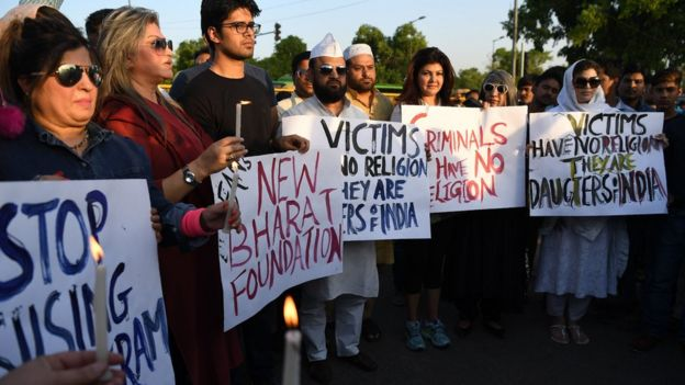 Indian demonstrators gather at the India Gate monument for a candlelight vigil in protest over the gang rape and murder of an eight-year-old girl, in New Delhi on April 14, 201