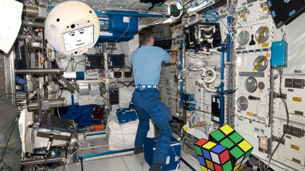 A mock-up image of the robot floating in the ISS