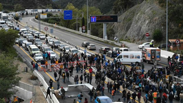Protesters block the AP-7 motorway at the Spanish-French border in La Jonquera, northern Spain, 11 November 2019