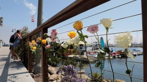 Flowers left at the dock in Santa Barbara after fire engulfed a diving vessel