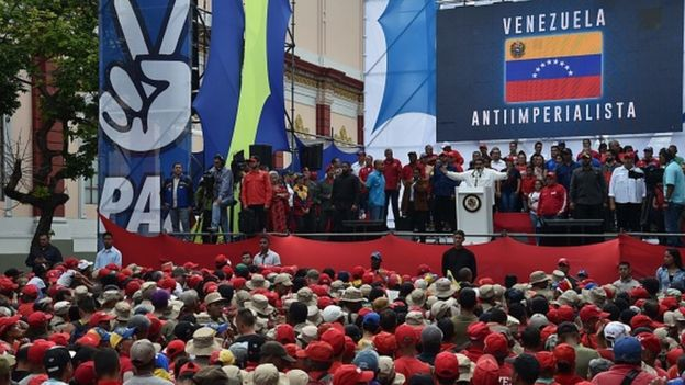 Venezuela's President Nicolas Maduro gestures during a rally at the Miraflores Presidential Palace in Caracas, Venezuela