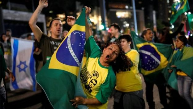 Supporters of Jair Bolsonaro, far-right lawmaker and presidential candidate of the Social Liberal Party (PSL), react after polls closed,