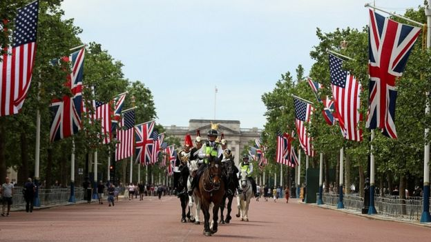 Police and the Horse Guards move past US and British flags along The Mall in advance of President Donald Trump's state visit to Britain. June 2, 2019